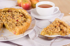 Tea served with rhubarb crumble tart Royalty Free Stock Image