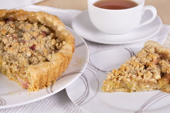 Tea served with traditional British crumble tart. Tea served with traditional British rhubarb crumble tart Stock Image