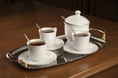 Tea service on silver tray Stock Photos