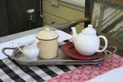 Tea Service. Tea set on a silver platter outside Royalty Free Stock Photo