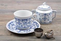 Tea service and ball Royalty Free Stock Photos