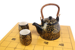 Tea service on chessboard Stock Image