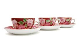 Tea service with floral pattern isolated Stock Photos