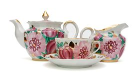 Tea service with floral pattern isolated Royalty Free Stock Photography
