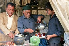 Tea serving and kebab roasting in small shack by road. Iraq. Stock Image