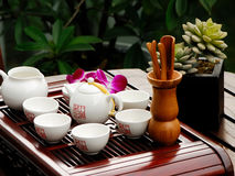 Tea set. White tea set with teapot, cups and flowers Stock Image