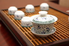 Tea set. Chinese tea set with a tray on a table Royalty Free Stock Photography