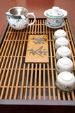Tea set. Chinese tea set with a tray on a table Royalty Free Stock Images