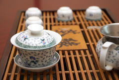 Tea set. Chinese tea set with a tray on a table Stock Image