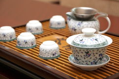Tea set. Chinese tea set with a tray on a table Royalty Free Stock Photo