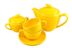 Tea set. Yellow tea set, isolated on white, clipping path included Royalty Free Stock Photos