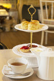 Tea set. Rose vanilla tea with scones on two tiered tray Royalty Free Stock Photos