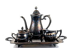 Tea Set. Antique tarnished tea set isolated Stock Photography