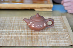 Tea set on bamboo mat Stock Photo