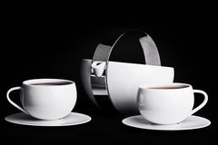 Tea set on black background. Tea pot with two cups of tea on black background Royalty Free Stock Photos