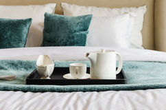 Tea set on black tray in bedroom Stock Photos