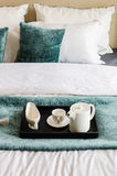 Tea set on black tray in modern bedroom Stock Image