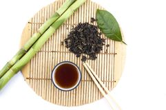 Tea set and a branch of bamboo Stock Photography