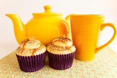 Tea set with caramel cupcakes Stock Photos