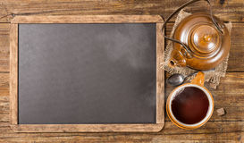 Tea set and  chalkboard, above view. Royalty Free Stock Photos