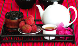 Tea set with chinese tea and litchees Stock Photos