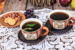 Tea set with cookies and fruit on doily Stock Images
