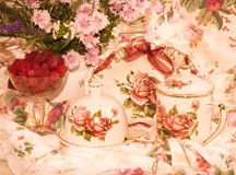 tea set, flowers and raspberry Royalty Free Stock Photo