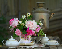 Tea Set and Flowers in Vintage Setting Royalty Free Stock Images