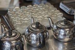 Tea set includes kettle and mug. Tea set includes kettle and mug, vintage Stock Photos