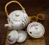 Tea set. Isolated beautiful tea set on wooden textured table Stock Photos