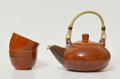 Tea set with kettle and two cups. At the white background Royalty Free Stock Images