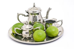 Tea set and limes Royalty Free Stock Photography