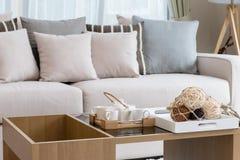Tea set in living room interior Stock Photos