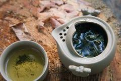 Tea set outdoors on a wooden stump Stock Image