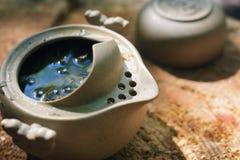 Tea set outdoors on a wooden stump Royalty Free Stock Photos