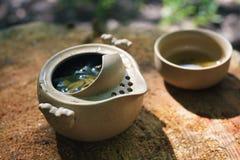 Tea set outdoors on a wooden stump Stock Photography