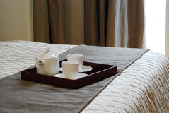 Tea Set in Room 3. Tea Set on the bed of a posh room Royalty Free Stock Photo