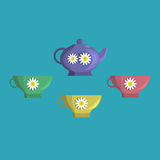 A tea set. A small set of teapot and cups on a blue background Stock Images