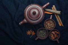 Tea set and spices. On the black textile Royalty Free Stock Image