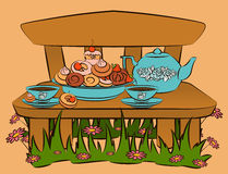 Tea set and sweet cakes on bench Royalty Free Stock Photo