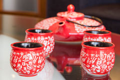 Tea set on table. Red tea set on glass table Royalty Free Stock Images