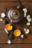 Tea set (teapot, cups and different green tea) a wooden background Royalty Free Stock Images