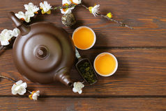 Tea set (teapot, cups and different green tea) a wooden background Stock Photo