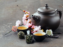 Tea set (teapot, cups and different  tea) Royalty Free Stock Photo