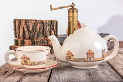 Tea set with teapot on wooden table Royalty Free Stock Photo
