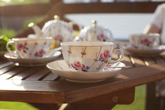 Tea set on terrace. On wooden table Royalty Free Stock Photos