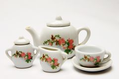 Tea set toy. Isolated shot of tea party set showing jug, sugar and creamer and cup and saucer royalty free stock images