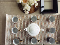 Tea set for visitors. English tea set with a teapot and eight cups for visitors in a luxurious house Royalty Free Stock Photo