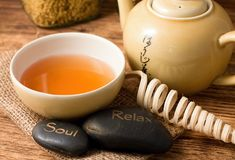 Tea set on wooden board and lava stones Stock Image