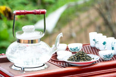Tea set on a wooden plate Stock Photos